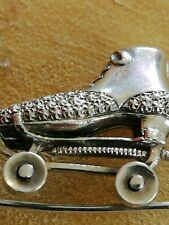Vintage Solid Silver small Skating Brooch. Stamped Silver