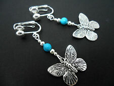 A PAIR TIBETAN SILVER DANGLY BUTTERFLY & TURQUOISE BEAD  CLIP ON EARRINGS. NEW.