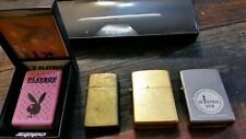lot of 4 zippo lighters and a zippo ball pen all originals pink zippo is new!!