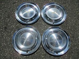 Factory original 1954 Desoto Firedome wheel covers hubcaps