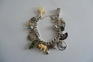VINTAGE SILVER CHARM BRACELET, HEART SHAPED LOCK, 29 CHARMS - C1960'S 82.6 GRAMS