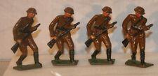 four VINTAGE metal  Toy Soldiers