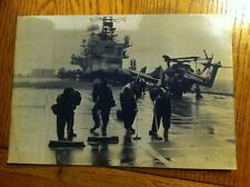 PRESS ASSOCIATION PICTURE OF HMS HERMES ON 27 MAY 1982 - SCRUBBING THE DECK