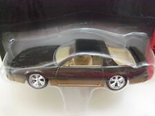 JOHNNY LIGHTNING - 1985 PONTIAC FIREBIRD TRANS AM (METALLIC BROWN) 1/64 DIECAST