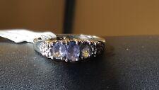 Vintage 10 k white gold tanzanite and diamond ring. 4