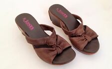 JONES BROWN SUPERSOFT LEATHER MULES WITH WEDGE HEEL. SIZE 37. KNOTTED FRONT