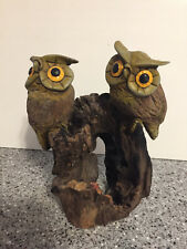 Wooden Owls Resting on Wood Branch