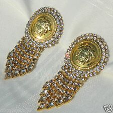 GIANNI VERSACE Large gold tone Medusa and rhinestone clip-on earrings from 1993