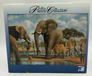 The Puzzle Collection Watering Hole 750 Piece  #97325 Brand New Zebras Elephants