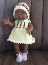 "Hard bodied Baby Doll  size approx 16"" in VG condition.New Hand knitted clothes"