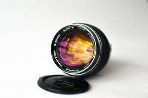 Olympus Zuiko 55mm f/1.2 lens + 4 Filters & caps