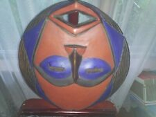 WOODEN AFRICAN TRIBAL MASK measures one foot 3 inches wide by one foot 4 inches