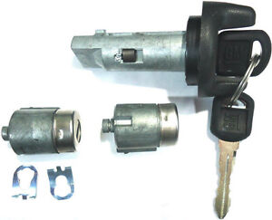 NEW GM OEM IGNITION SWITCH LOCK CYLINDER + 2 DOOR LOCK CYLINDER + 2 LOGO KEYS