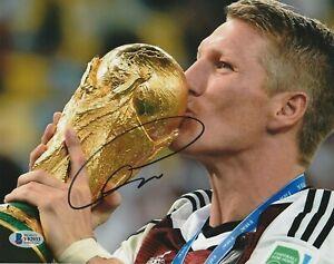 BASTIAN SCHWEINSTEIGER Signed FIFA TROPHY 8x10 PHOTO w/ Beckett COA