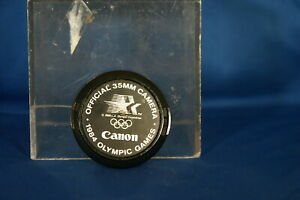 1984 OLYMPIC GAMES CANON OFFICIAL 35 MM LENSE CAP C-52 mm