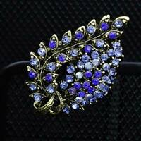 superbe broche  métal doré & pierre cristal bleu