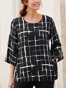 Lightly Rippled Flowing Viscose a Line Tunic Style Blouse In a Monochrome Design