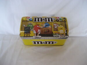 M&M'S-   M&M YELLOW (LIBRARY SCENE) HINGED TIN-  EXCELLENT CONDITION