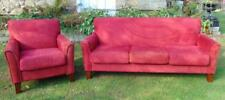Contemporary three cushion red sofa, along with a contemporary red up. Lot 104