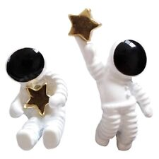 Mismatched white and black enamel astronaut and star clip on earrings