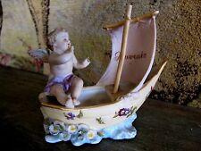 ancien biscuit l'ange ou chérubin sur un voilier souvenir