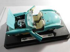 1957 Chevrolet Corvette on Base 1:24 Scale Diecast Blue - O
