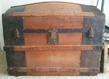 antique dome top steamer trunk with interior pictoral wall paper
