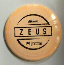 Discraft Paul McBeth Zeus Distance Driver light orange w/ colored bubbled stamp