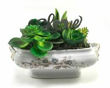 Faux succulent floral arrangement in vintage china boat with blue flowers & Love