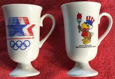 LOT OF 2 FOOTED MUG CUP SAM THE EAGLE 1984 LOS ANGELES OLYMPIC GAMES PAPEL