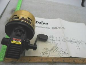 VINTAGE DAIWA GC-100 GOLD CAST Spincast FISHING REEL MADE IN JAPAN WITH PAPER
