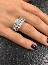 18k white gold and 1ct plus side diamond  ring