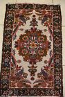 CARPET/RUG FROM THE 1960s; 38 in x 23.5 INCH; WHITE BACKGROUND; RED/ROSE DESIGN