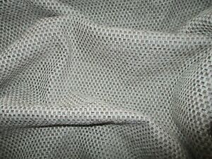 ROLL END OF 1.6 METRES OF A QUALITY WOVEN UPHOLSTERY FABRIC IN GREY AND BROWN.