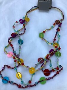 Multi coloured necklace three rows small beads on cord