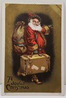 A Joyful Christmas Embossed Santa with Suitcase c1910 Postcard A1