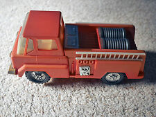 Vintage early 1970s Playart 8 inch Fire Engine w/ rotating battery power wheels