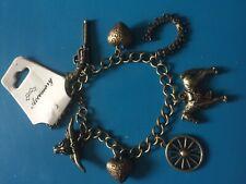 Antique bronze horse shoe charm bracelet heart gun bull western