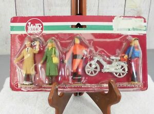 LGB (5048)  (4) HAND PAINTED FIGURES and a BIKE  (01)