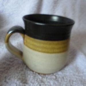 studio pottery mug unmarked, brown,tan,brown rings. 8.5 cm tall good