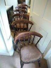 Set of 6 sturdy solid round backed chairs.