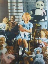 vintage Little girl with lots of old fashioned dolls toys