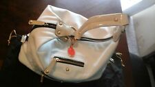 Tod's ivory satchel purse with black trimming.