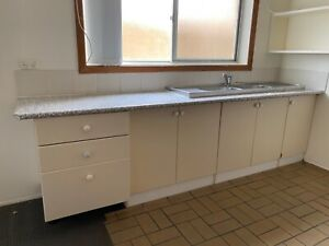 used kitchenette, drawers, cutlery insert, cupboard doors, double sink and tap.