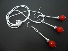 A SILVER PLATED RED CARNELIAN NECKLACE AND EARRING SET. NEW.