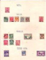 17 old NATAL,NIGERIA,RHODESIA,SIERRA LEONE stamps on an album page.