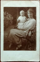 Photograph of a Woman and Baby in a Garden Antique Postcard