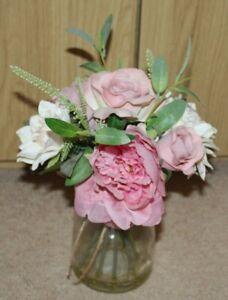 Artificial Pink Roses in Glass Jar