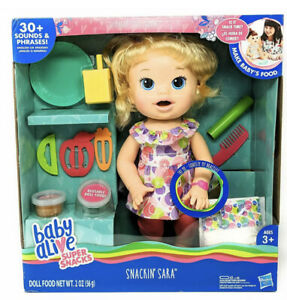 Baby Alive Snackin Sara Blonde Doll: Eats Poops Talks English Or Spanish