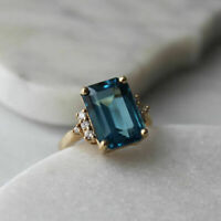 1 CT Emerald Cut London Blue Topaz 14k Yellow Gold Over Diamond Solitaire Ring